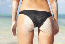 Woman buttocks on tropical beach
