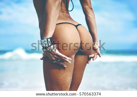 Woman buttocks slim figure on sea background #570563374