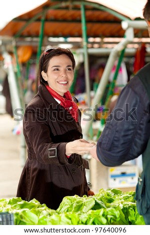 Woman buying at the green market