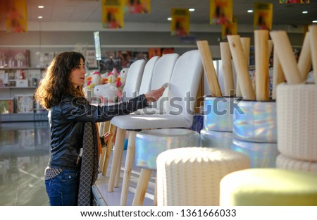 Woman buying furnitures in shop, selecting products #1361666033