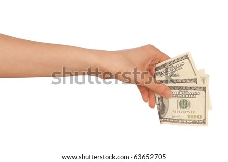 Woman buying goods in the supermarket with dollars