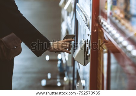 Woman buying with a vending machine #752573935