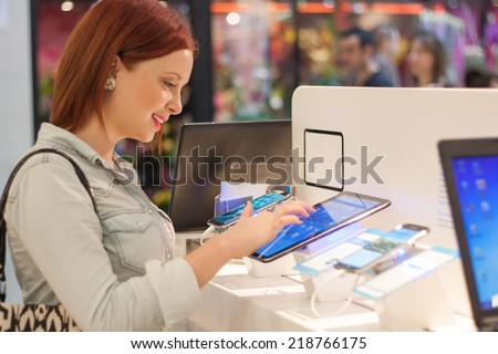 woman buys a digital tablet