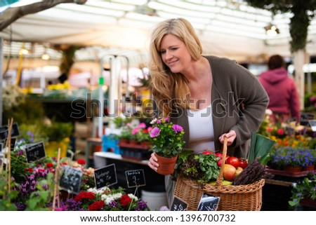 Woman buys flowers in the market