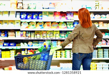 Woman buys fresh food at the supermarket