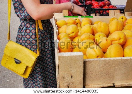Woman buys fruits in the market