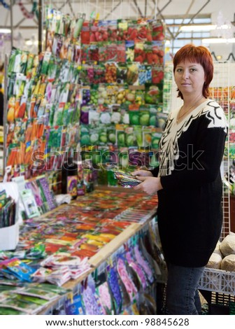 woman buys the seeds on the market