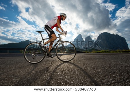 woman by road cycling competition