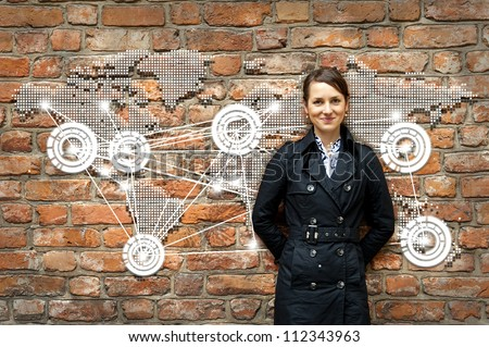 Woman by the wall with world map travel