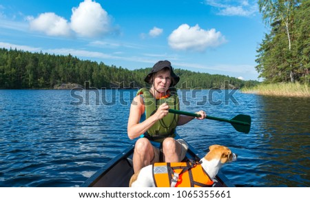 Woman canoeing on the lake #1065355661