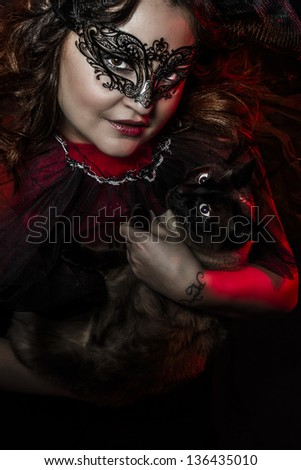 woman caressing a Siamese cat
