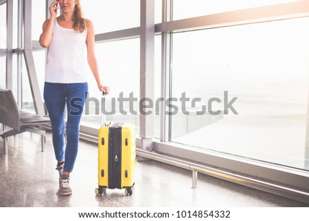 Woman carries your luggage at the airport terminal of Hong Kong, after gonna stady or education fly to Singapore #1014854332