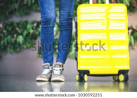 Woman carries your luggage at the airport terminal of Hong Kong, after gonna stady or education fly to Singapore #1030592251