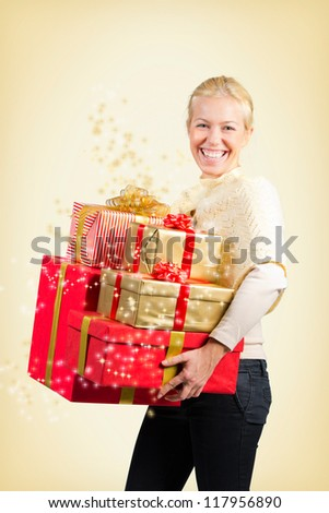Woman carrying a lot of Christmas presents on yellow background