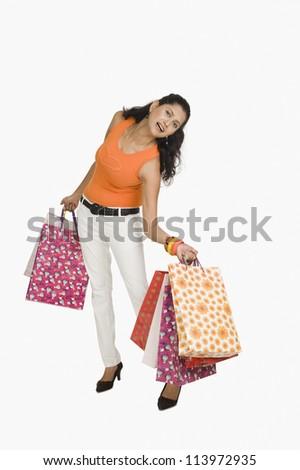 Woman carrying heavy shopping bags