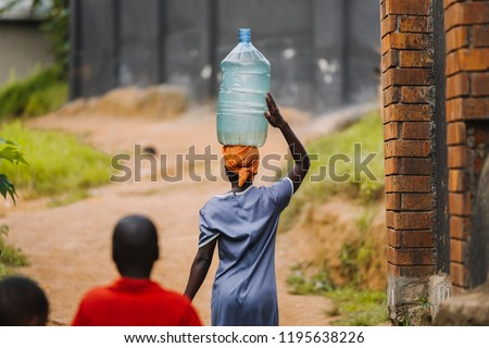 woman carrying water can in Uganda, Africa #1195638226