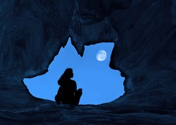 Woman Caver Spelunker exploring inside of a Dark Cave. female sitting at the edge of the cave hole.wolf shaped of cave hole.Silhouette of a girl standing in front of the entrance to the cave.full moon