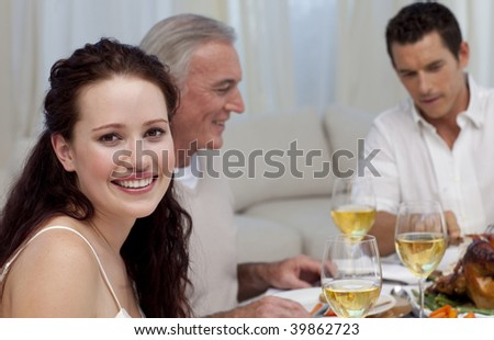 Woman celebrating Christmas dinner with her family at home