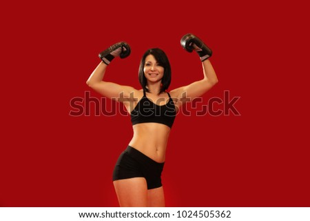 Portrait of sport girl hands up boxing wearing red gloves