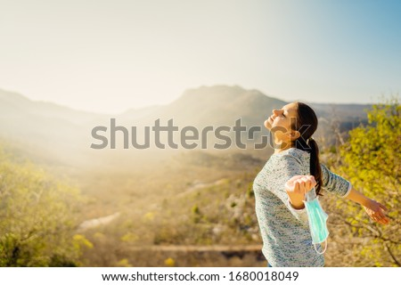 Woman celebrating without mask.Concept of defeating illness.Recovered from coronavirus.Cured disease emotional patient.Covid-19 virus outbreak problems solved.Immunity to virus.Stress free.Breathing Photo stock ©