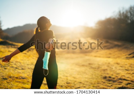 Woman celebrating without mask.Concept of defeating illness.Recovered from coronavirus.Cured disease emotional patient.Covid-19 virus outbreak problems solved.Immunity to virus.Stress free.Breathing Foto stock ©