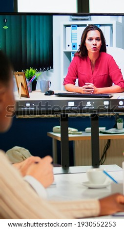 Woman ceo speaking at webcam during virtual business video presentation for business partners. Confident businesswoman talking to web cam streaming webcast training, doing online conference call.