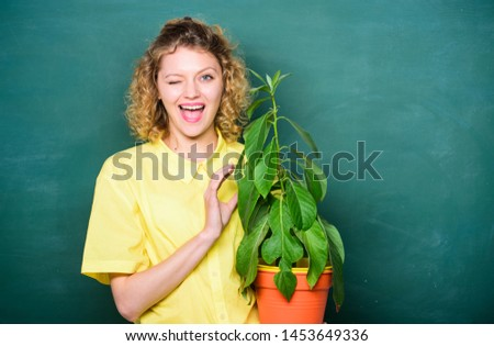 Woman chalkboard background carry plant in pot. Take good care plants. Florist concept. Botany and biology lesson. Botanical expert. Botany education. Botany is about plants flowers and herbs. #1453649336