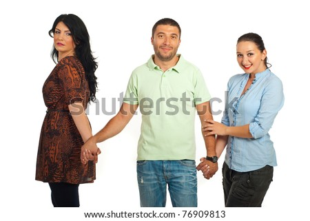 Woman cheated looking with envy face to smiling man who holding other woman hand isolated on white background