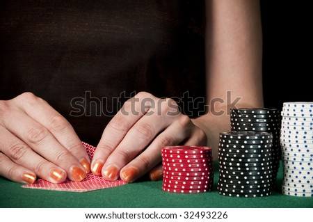 woman checking cards on texas holdem