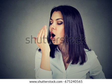 Woman checking her breath with hand. #675240565