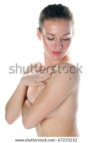 woman checking suspicious mall on her skin