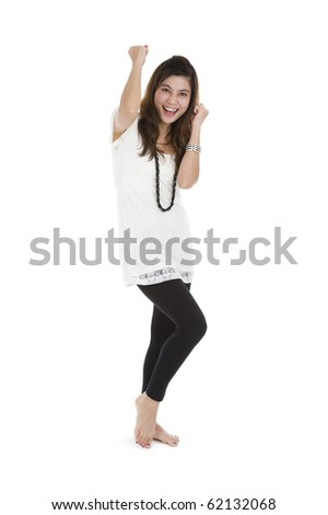 woman cheering and dancing with her fists in the air, isolated on white background