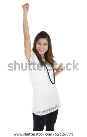 woman cheering with her fist in the air, isolated on white background