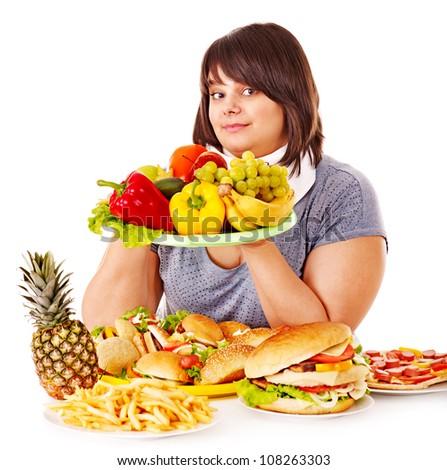 Woman choosing between healthy eating and hamburger.