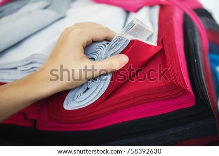 Woman choosing fabric colors. #758392630
