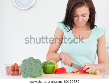 Woman chopping vegetables in her kitchen