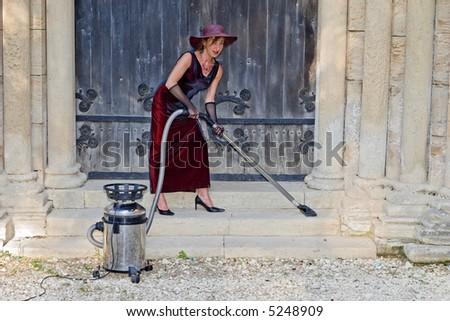 woman cleaning ancient church stairs with hoover