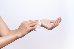 Woman cleaning her hands with white soft tissue paper. isolated on a white backgrounds