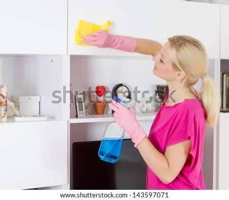Woman cleaning house.