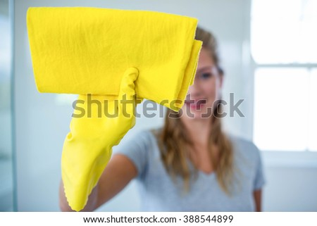 Woman cleaning the bathroom in her house #388544899