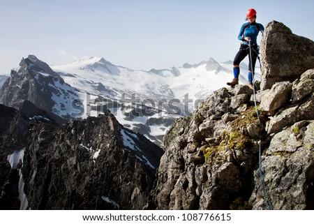 Woman climber in summer Austrian Alps