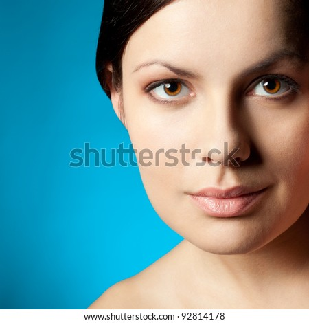 woman closeup beauty face over blue background