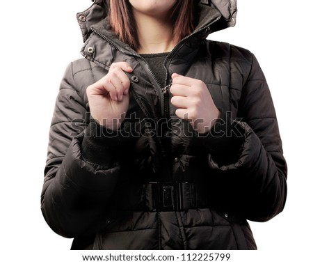 Woman closing up her jacket