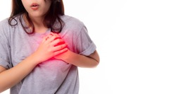 Woman clutch chest from acute pain of heart attack symptom. Severe heart ache, young woman suffering from chest pain, having heart attack or painful cramps, pressing on chest, coronary artery disease