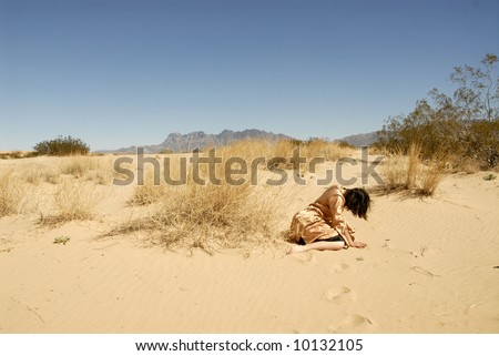 Woman collapsed in the desert seeker of the mirage or journey of the