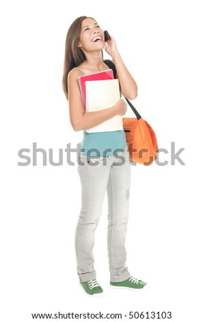 Woman college student standing isolated in full length. Mixed race Asian Chinese / caucasian. Female university student talking in mobile phone. Cutout isolation on white background.