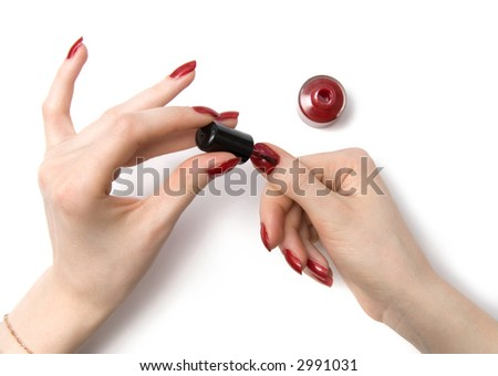 Woman color her red nails. On white with shadows.