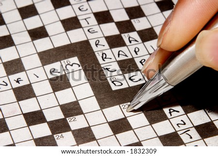Woman completing crossword