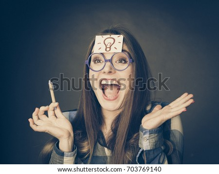 Woman confused thinking seeks a solution, paper card with light idea bulb on her head. Excited girl with many ideas celebrating success. Eureka creativity concept