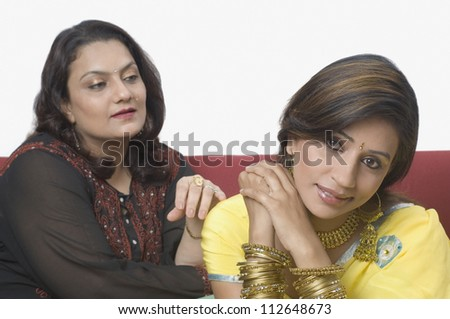 Woman consoling her daughter